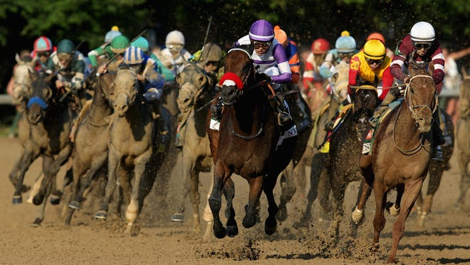 Nyquist runs to victory in the Kentucky Derby.