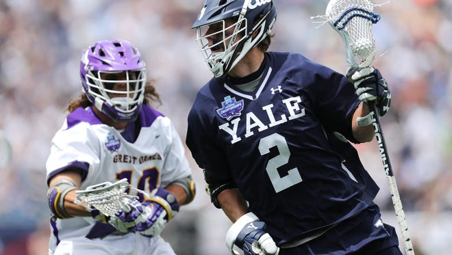 Yale's Ben Reeves, a Palmyra-Macedon graduate, makes a move on Albany's Troy Reh during the men's lacrosse semifinals last weekend. Reeves led Yale to its first national championship and received the Tewaaraton Award as the top player in college lacrosse on Thursday.