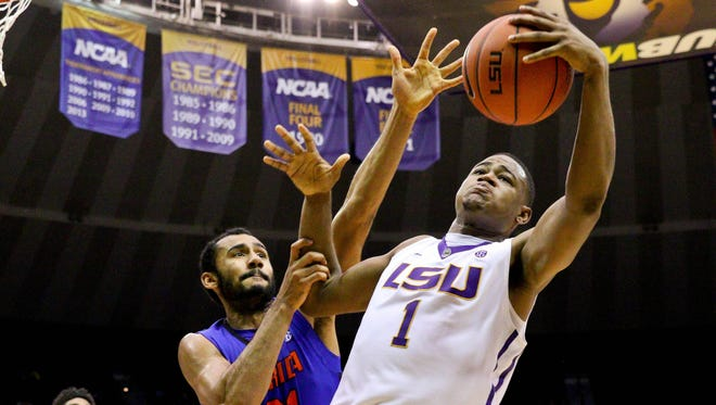LSU Tigers forward Jarell Martin (1) rebounds over Florida Gators forward Jon Horford (21) during second half of a game at the Pete Maravich Assembly Center.
