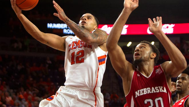 Clemson Tigers guard Avry Holmes (12) moves to the basket while being defended by Nebraska Cornhuskers forward Ed Morrow (30) during the second half at Littlejohn Coliseum.