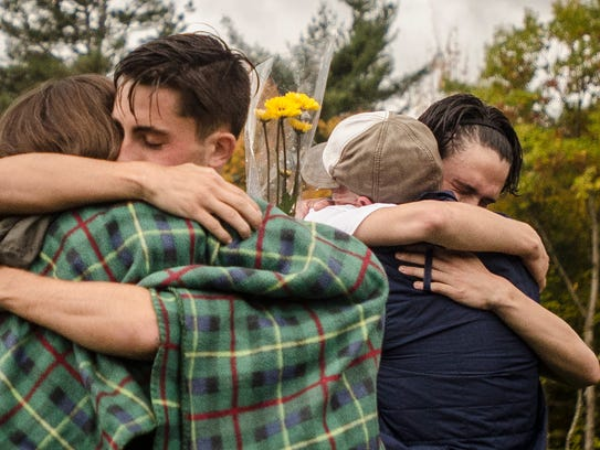 Harwood soccer players hug their parents during the