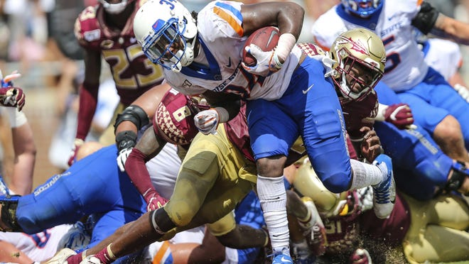Boise State running back Robert Mahone (34) crosses the goal line scoring the winning touchdown during the fourth quarter of an NCAA football game against Florida State on Saturday, Aug. 31, 2019 in Orlando, Fla.