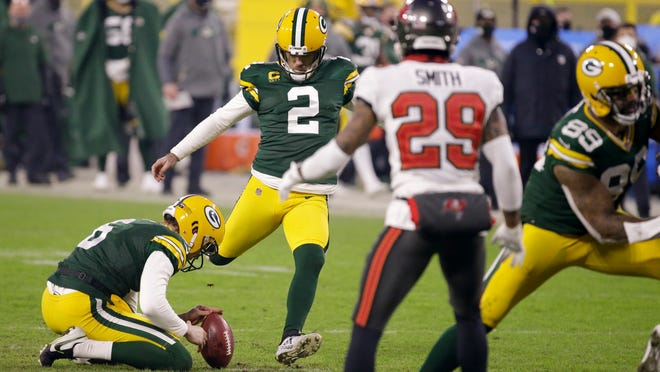 The Packers' Mason Crosby kicks a 26-yard field goal against Tampa Bay that produced the final points in the Bucs' 31-26 victory in the NFC Championship Game.