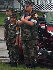 Members of the Space Coast Young Marines wait to assist