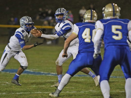 R.E. Lee quarterback Jayden Williams hands off the