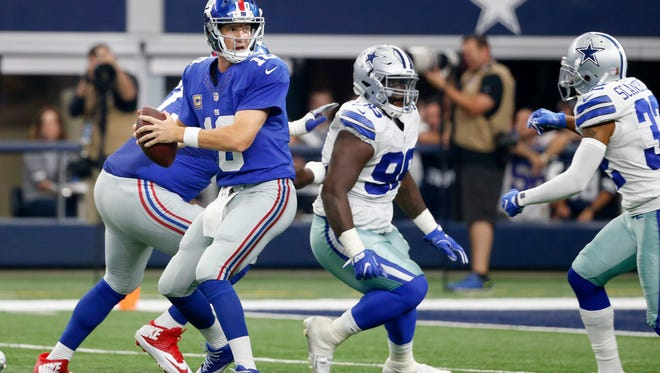 New York Giants quarterback Eli Manning (10) looks to pass against the Dallas Cowboys during an NFL football game, Sunday, Sept. 11, 2016, in Arlington, Texas.