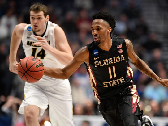 Florida State guard Braian Angola (11) moves the ball