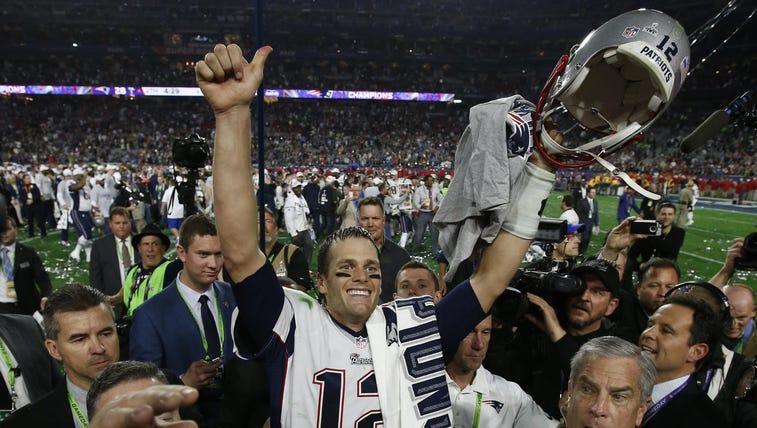New England Patriots quarterback Tom Brady (12) celebrates