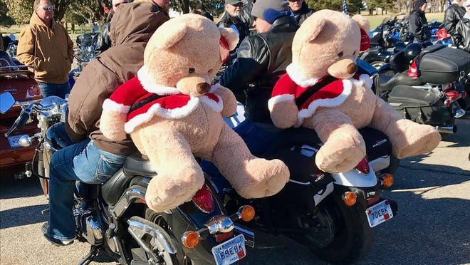 Salinans Len and Robyn Schneider strapped large teddy bears to their backs before embarking on the Salina Toy Run in 2018.