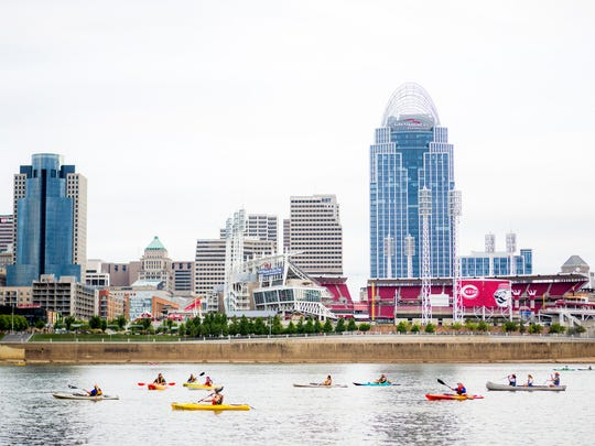 Paddlefest participants kayak on the Ohio River at the 15th Annual Paddlefest Saturday, Aug. 6, 2016.