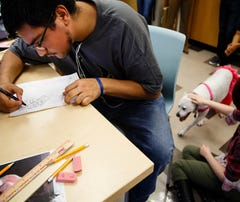 Photos: ARL and Scavo students team up to make adult coloring book