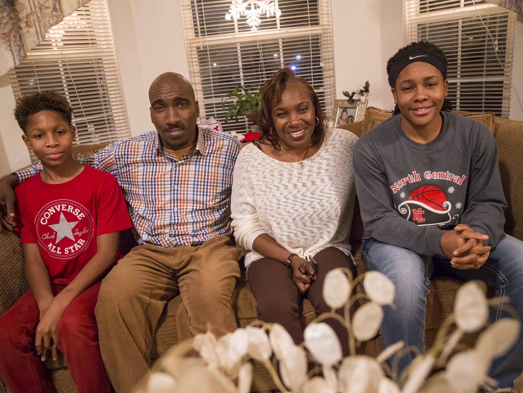Paul Lee, Delawrence Thomas, Debra Hawkins and Ajanae Thomas pose for a portrait on Monday, Dec. 19, 2016.