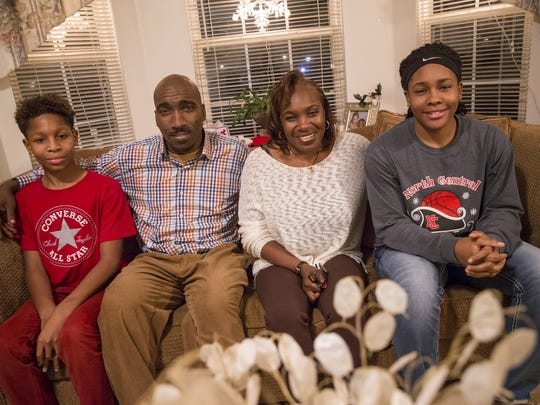 Paul Lee, Delawrence Thomas, Debra Hawkins and Ajanae Thomas pose for a portrait on Monday, Dec. 19, 2016.