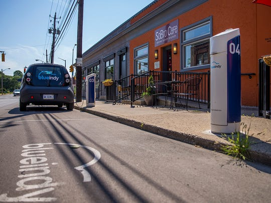 BlueIndy has installed a station of five parking spots for their rentable smart cars, eliminating a stretch of public parking in front of SoBro Cafe along 52nd Street, Indianapolis, Monday, July 31, 2017. Some business owners say the BlueIndy stations have occupied public parking that was integral to their business.