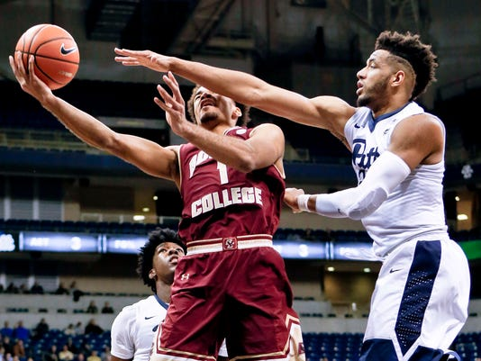 Boston College's Jerome Robinson (1) tries a shot next to Pittsburgh's Terrell Brown, right, during the first half of an NCAA college basketball game Tuesday, Feb. 13, 2018, in Pittsburgh. (AP Photo/Keith Srakocic)