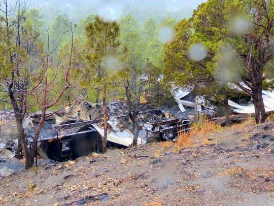The morning after the fire, heavy rain fell on the
