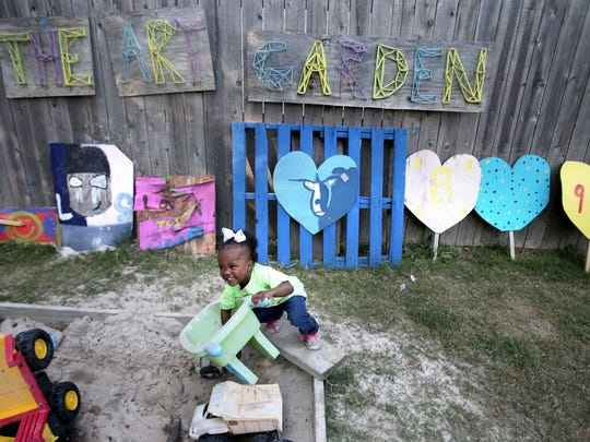 Alanah Crawford, 2, plays in the sandbox at Carpenter Art Garden.