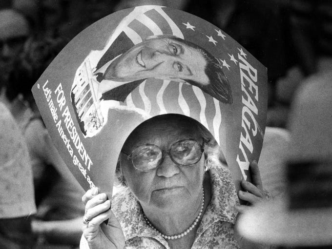 Christina Whittemore, a Democrat from Mayfield, used a Reagan poster as a sunbonnet yesterday during the 100th annual Fancy Farm political barbecue. This was her 60th Fancy Farm. Photo published Aug 3, 1980.