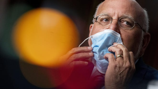 """Centers for Disease Control and Prevention Director Robert Redfield, M.D., puts his mask back on after speaking at a Senate Appropriations subcommittee hearing on a """"Review of Coronavirus Response Efforts"""" on Capitol Hill on Sept. 16."""