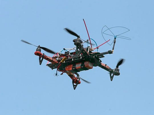 A Quad Flip FPV Pro drone hovers under the operated