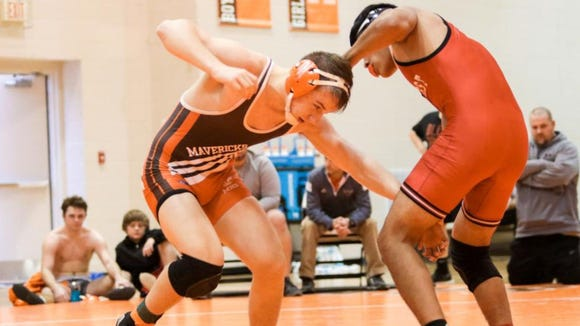 Mauldin's Jeremy Fisher, left, a junior and the Mavericks' 170-pounder, won a Greenville County championship and took fourth in the state last season.