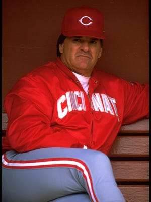 Manager Pete Rose of the Cincinnati Reds looks on from the dugout at Candlestick Park in San Francisco, California.