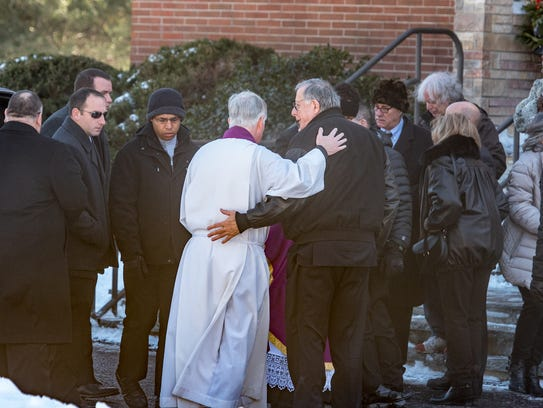 People exit the funeral service at St. Jerome's RC