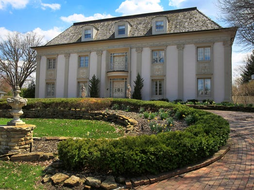 Built in 1974, this 13,000-square-foot Italian-inspired estate at 515 Round Hill Road on Indianapolis' FarNorthside has four floors with eight bedrooms, eight full baths, three half-baths, three full kitchens and an Art Deco party room. The home is for sale for $799,900.