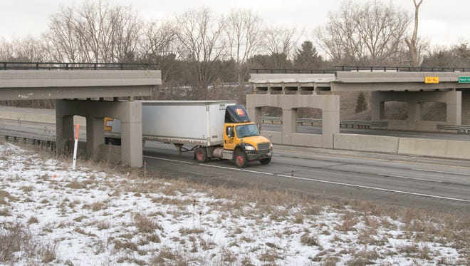 The Pleasant Valley Road overpass shown Thursday, Feb. 1, 2018, partially demolished due to structural damage after it was damaged by a truck hauling equipment, was replaced and reopened to traffic.