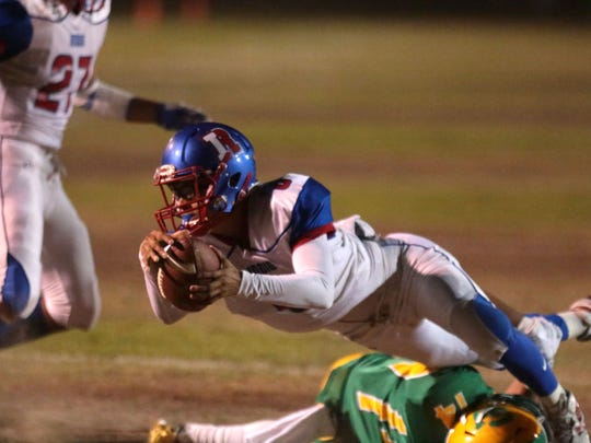 Indio's Dimitri Long carries the ball within the Coachella Valley 10 yard line in the first quarter during the Bell Game on Friday, September 16, 2016 in Thermal.