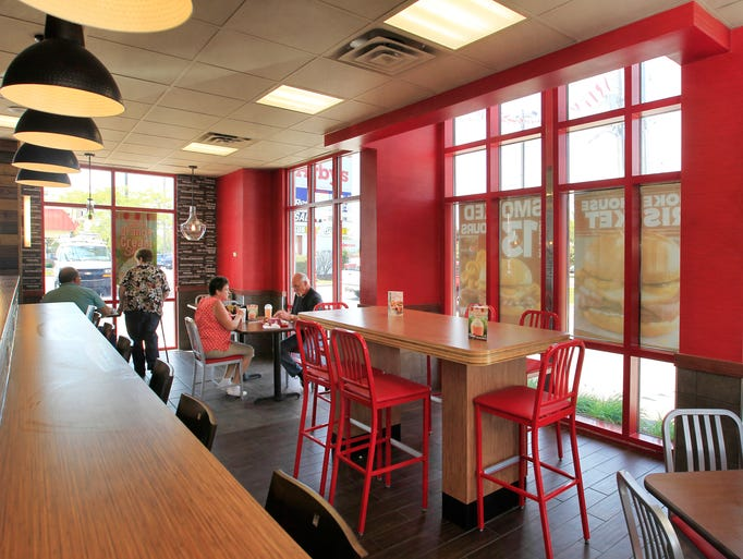 A laptop bar with free Wi-Fi, left, and family gathering table, center, are features of the extensive redo of the Arby's restaurant at 4925 S. Emerson St. on Indianapolis' Eastside that will have will have a public unveiling on Saturday. Photographed on Friday, May 30, 2014.