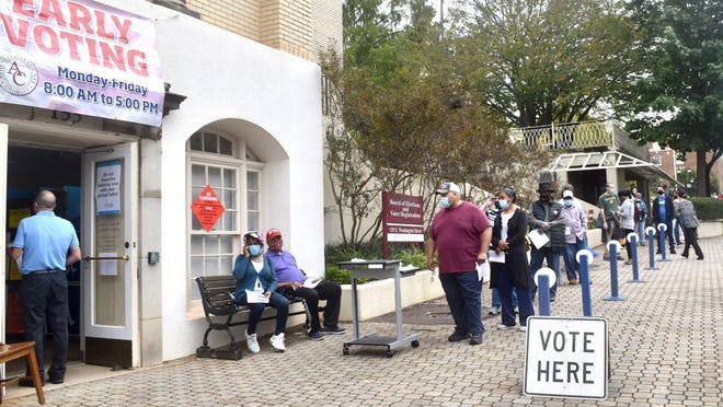 Some waited more than two hours to vote during early voting Monday at the Athens-Clarke County Board of Elections office.