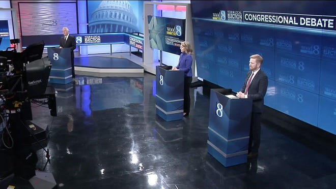Congressional candidates Hillary Scholten, a Democrat and Peter Meijer, a Republican, participate in their first debate Thursday, Oct. 1.