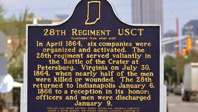 historic marker in the 700 block of South Virginia Ave. recognizing the 28th Regiment of U.S. Colored Troops from Indiana who served int he Union Army during the Civil War.   Joe Vitti / The Star   July 19, 2013.