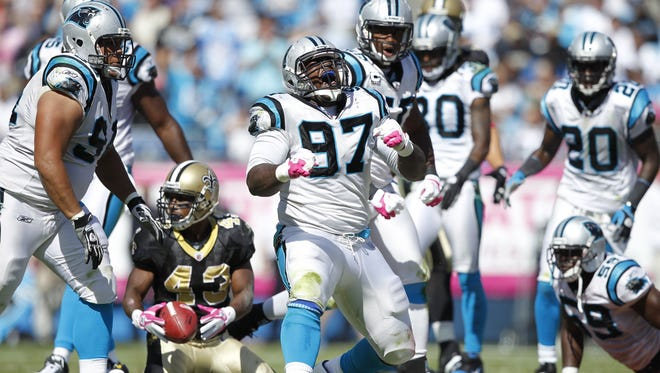 Pensacola High graduate Terrell McClain celebrates making a tackle for the Carolina Panthers during a game against the New Orleans Saints in 2011 in Charlotte, North Carolina.