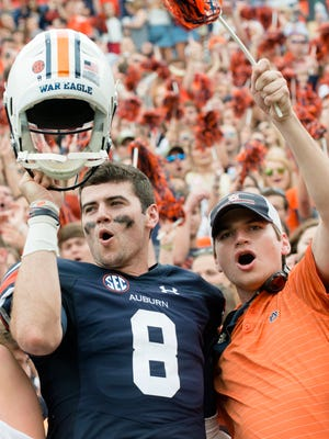 Auburn quarterback Jarrett Stidham (8) celebrates after the NCAA football game between Auburn and Ole Miss on Saturday, Oct. 7, 2017, in Auburn, Ala. Auburn defeated Ole Miss 44-23.