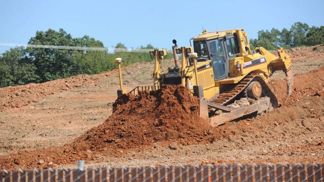 Construction crews continue to move earth Thursday on the site of the new General Leonard Wood Army Community Hospital campus.
