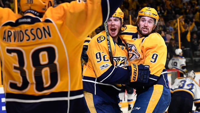Predators center Ryan Johansen (92) celebrates his goal with center Filip Forsberg (9) and right wing Viktor Arvidsson during the third period of Game 6 on May 7, 2017.