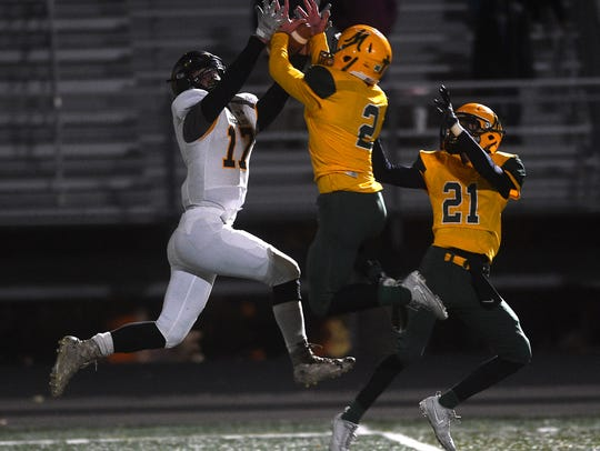 Bishop Manogue's Angelo Reviglio (2) breaks up a pass