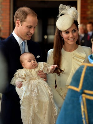 Britain's Prince William and Kate, Duchess of Cambridge, with their son, Prince George, arrive at Chapel Royal in St James's Palace in London for the christening of the three-month-old on Wednesday, Oct. 23, 2013.