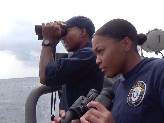 Commander Chris Brown, left, commanding officer of