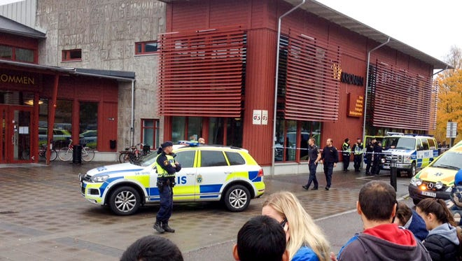 Swedish police are at the scene after a masked man attacked people with a sword at the Kronan school in Trollhaettan in western Sweden Oct. 22, 2015.