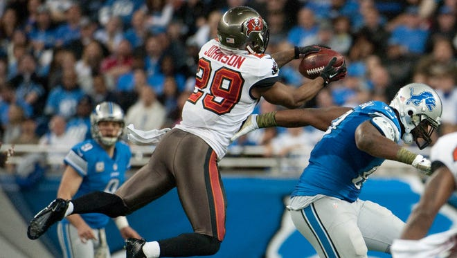 Tampa Bay Buccaneers cornerback Leonard Johnson (29) intercepts a pass and runs it back for a touchdown during the second quarter against the Detroit Lions at Ford Field.