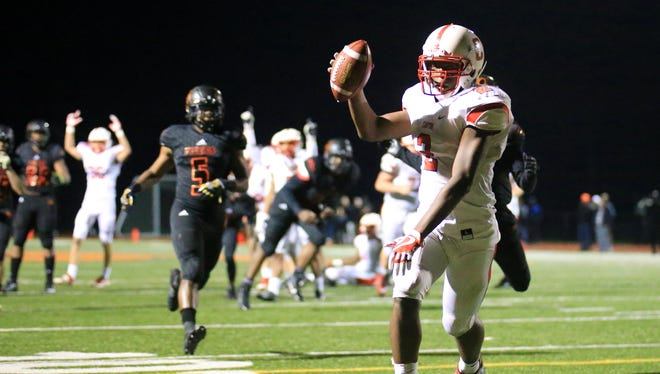 In this photo from a 2017 playoff game, Canton's Noah Brown (2) scores a touchdown against Belleville. This season, the Chiefs and Tigers both are in the Kensington Lakes Activities Association.