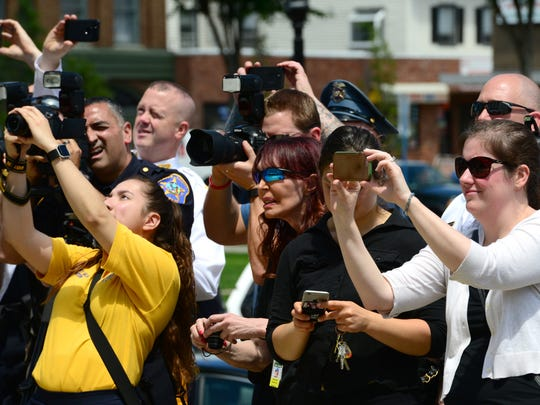 Family members photograph their child in the group shot of more than two dozen local and county law enforcement agencies that participated in the Seventh Annual Bergen County Chief for a Day celebration on Friday.