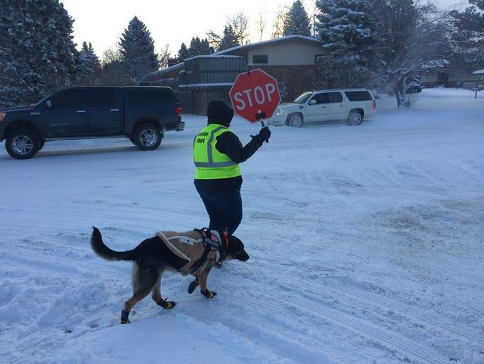 RIchelle Alwerdt and her dog Kida help Meadowlark Elementary