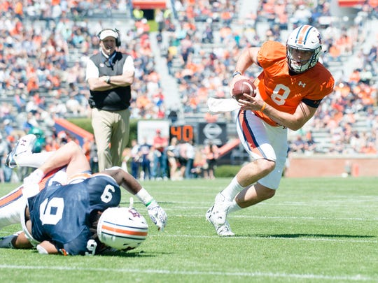 Auburn quarterback Jarrett Stidham (8) recovers a fumble  and runs for a touchdown during Auburn's A-Day on Saturday, April 8, 2017, at Jordan Hare Stadium in Auburn, Ala.