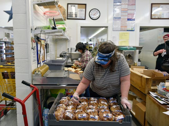 Sue Myers labels sandwiches while preparing more than 2,000 subs and rolls for a Craley-area fundraiser Thursday, March 15, 2018, at Sue's Market in Wrightsville. Myers, who's celebrating her 10th anniversary as the owner of Sue's Market, purchased the business from the previous owner after she'd already worked there for 25 years.