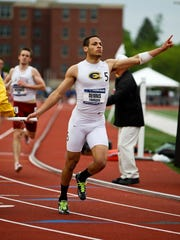 Thurgood Dennis competes on the Blugolds' 1600 relay