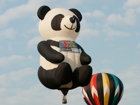 The 110-foot-tall Unique Photo Panda balloon.